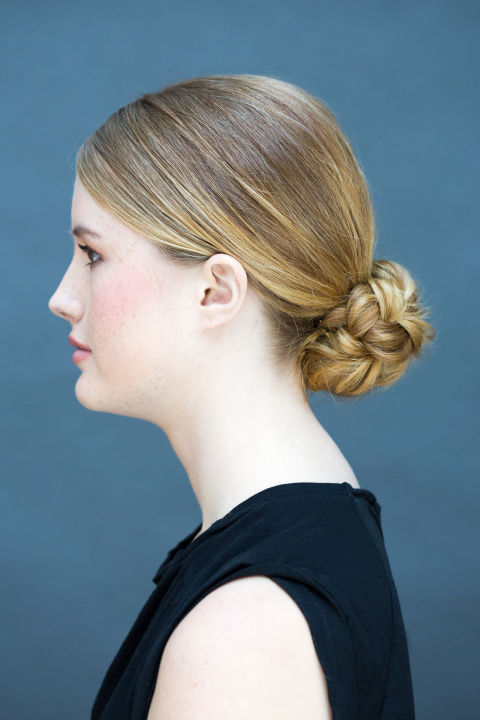 Show off an unexpected twist with this no-nonsense braided bun.