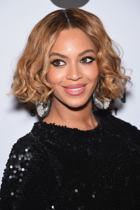 Bey goes the perfectly-coiled route on her ends and the results are '20s lob-meets-today.