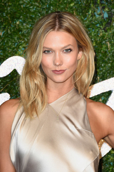 The supermodel streamlines her waves for a look that's equal parts au naturale and refined.