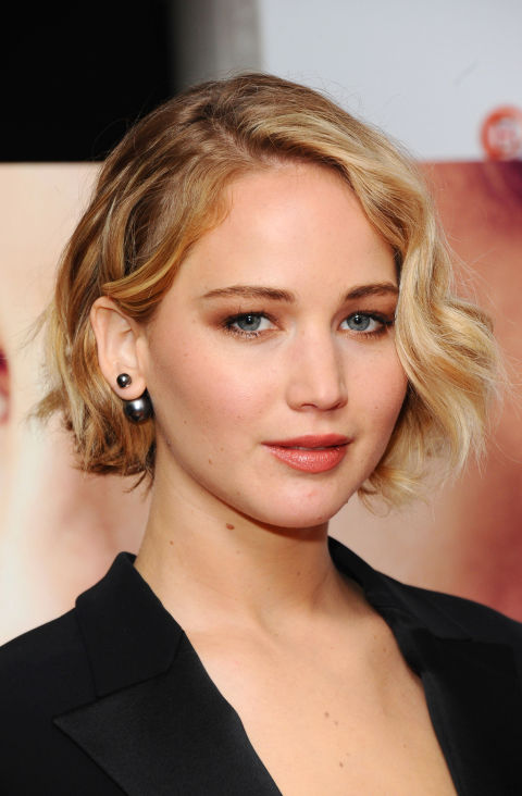 J-Law frames her face with artfully-curled pieces that are never too perfect.