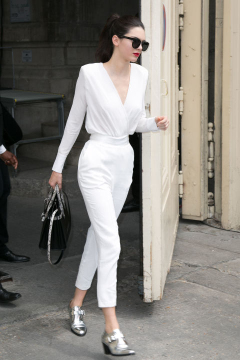 Leaving the Chanel show in Paris, she keeps things fresh in a white jumpsuit and the same silver brogue boots she wore the day before.