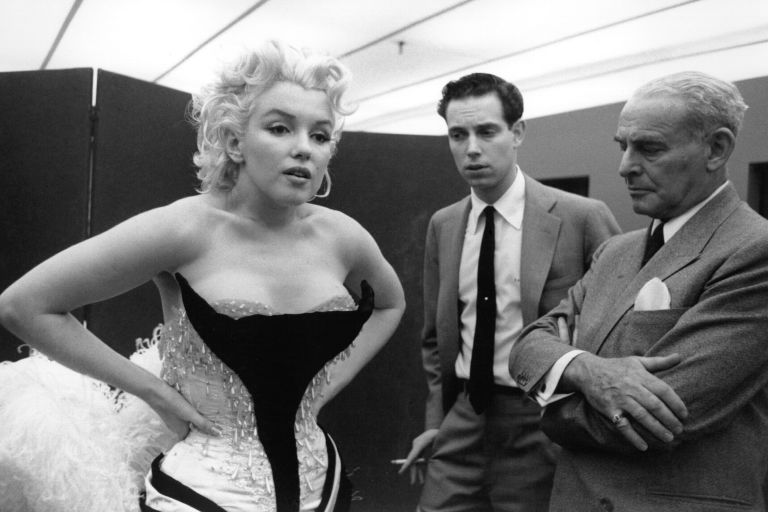 NEW YORK - MARCH 1955: Movie star Marilyn Monroe gets fitted for her costume in a dressing room before riding a pink elephant in Madison Square Garden for a circus charity event in March 1955 in New York City, New York. (Photo by Ed Feingersh/Michael Ochs Archives/Getty Images)
