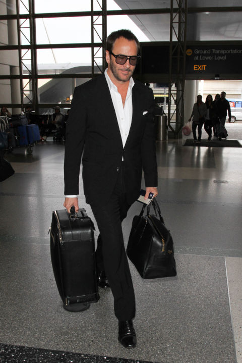 The look: A trim suit, white shirt, and not a laser-precision-trimmed hair out of place. Not even at the airport.