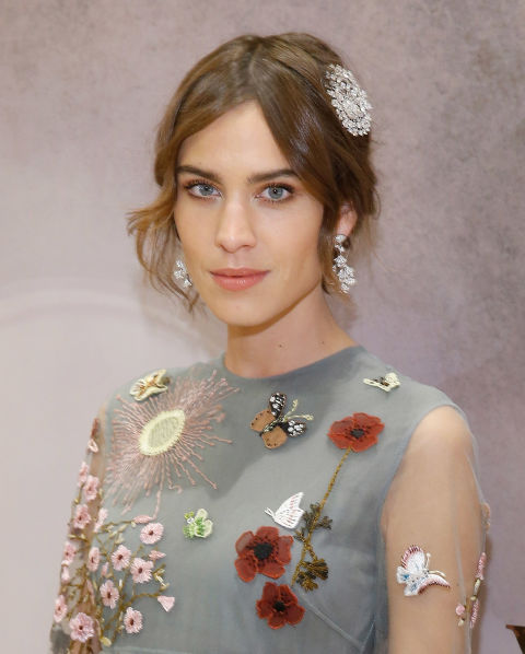 Alexa Chung makes the best of short lengths with some hair jewels and a center part that allows for even, draping tendrils to frame her face.