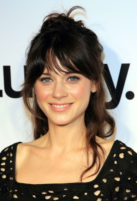 Deschanel perfects this lazy girl red carpet style by pulling her naturally wavy hair into a messy bun, flyaways and all.