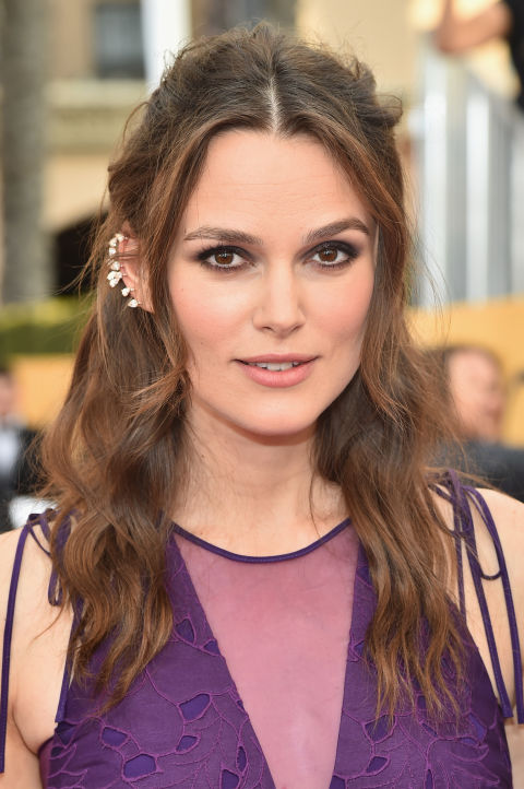 Knightley opts for a middle part and face-framing strands that offset her impressive ear candy.