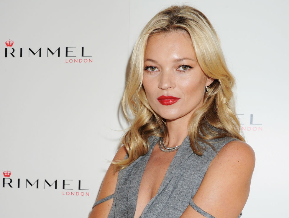 """LONDON, ENGLAND - SEPTEMBER 15: Kate Moss at a photocall to launch her personally designed lipstick range for the brand """"Kate Moss Lasting Finish Lipstick Collection"""" at Claridges Hotel on September 15, 2011 in London, England. Kate wears shade No.1 from her collection. (Photo by Dave M. Benett/Getty Images for Rimmel)"""
