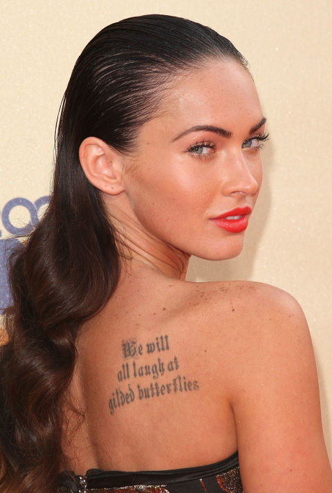 "The Transformers star has been inked and de-inked a couple times before (she got rid of her Marilyn Monroe tattoo to avoid ""attracting negative energy"") but the most prominent is the script on her back that adapts a line from Shakespeare's King Lear. It reads, ""We will all laugh at gilded butterflies"" and she has been quoted saying that it's a reminder ""to not get too caught up in Hollywood because people will end up laughing at you."""
