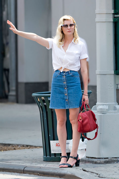 Kirsten Dunst looks like an all-American girl in a white front-tie collared shirt and a true-blue denim skirt. Get the Look:  Rag & Bone Button Front Denim Skirt, $198; nordstrom.com.