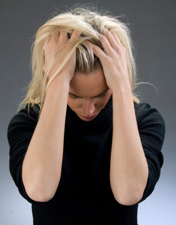blond woman with her hands in her hair