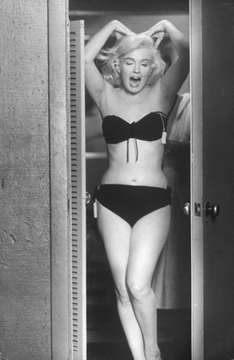 Trying on wardrobe options in August 1960.