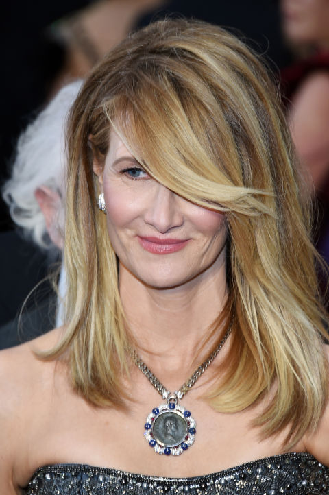 Saved the best for last: behold the swoopiest of swoopy bangs. Flick your hair back from your face when you're blow drying and then spritz with some hair spray for this gravity-defying hair.
