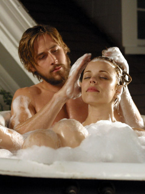 """Poor boy (Ryan Gosling) and rich girl (Rachel McAdams) fall in love during a hazy Southern summer in the 1930s. Fifty years later, an elderly man reads their story to a woman with Alzheimer's in a nursing home. Please fetch the tissues; we'll just be over here watching the famous """"kiss in the rain"""" scene on repeat. Starring: Ryan Gosling, Rachel McAdams Released: 2004"""